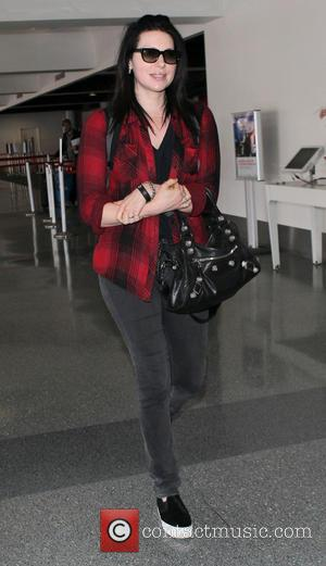 Laura Prepon - Laura Prepon arrives at Los Angeles International...