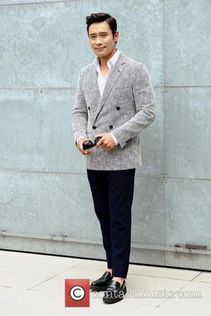 Lee Byung-Hung - Milan Fashion Week Menswear Spring/Summer 2015 - Giorgio Armani - Backstage - Milan, Italy - Tuesday 24th...