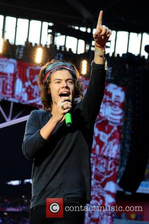 One Direction and Harry Edward Styles - One Direction performing live in concert during their 'Where We Are' tour at...