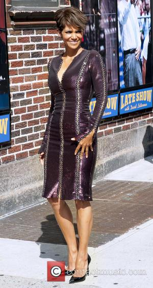 Halle Berry - Halle Berry, wearing a corset style plum dress, arrives at the Late Show with David Letterman -...