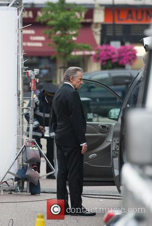 Harvey Keitel - Harvey Keitel's car is investigated by a parking enforcement officer while filming a commercial in North London....