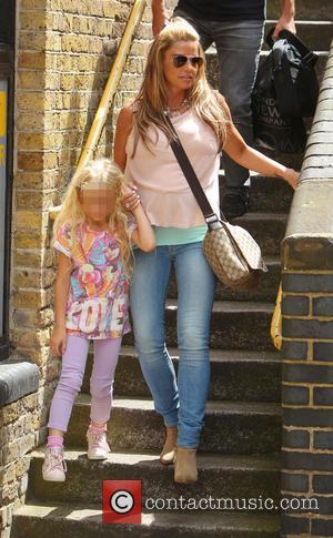 Katie Price and Princess Tiiaami - Katie Price and her daughter Princess Tiiaami seen leaving FUBAR Radio - London, United...
