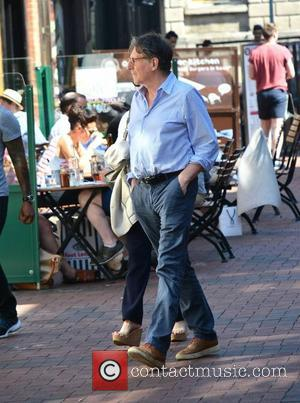 Gabriel Byrne - Gabriel Byrne out and about with a mystery blonde woman close to the Powerscourt Towncentre - Dublin,...