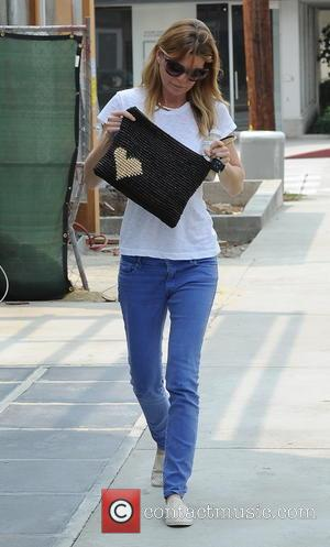 Ellen Pompeo - 'Grey's Anatomy' star Ellen Pompeo, casually dressed in a white T-shirt and skinny jeans, goes to the...