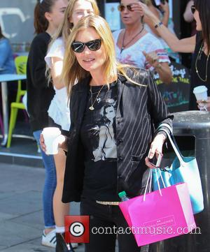 Kate Moss - Kate Moss, wearing an Amy Winehouse T-shirt, out in Primrose Hill with her daughter Lila Grace and...