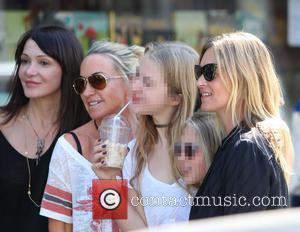 Kate Moss, Lila Grace, Anais Gallagher and Meg Mathews - Kate Moss, wearing an Amy Winehouse T-shirt, out in Primrose...