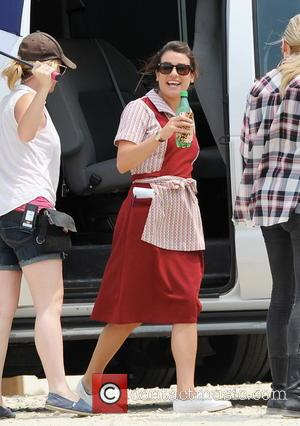 Lea Michele - Lea Michelle is seen wearing a waitress outfit and smoking cigarettes with co-star Katey Sagal outside a...