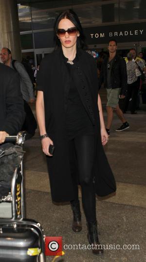 Eva Green - Eva Green arrives at Los Angeles International (LAX) airport - Los Angeles, California, United States - Friday...