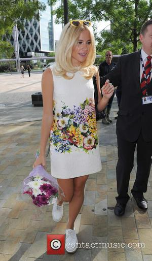 Pixie Lott - Pixie Lott leaves BBC Breakfast to promote her new album which is released today. - Manchester, United...