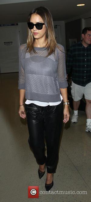 Jessica Alba - Jessica Alba arrives at Los Angeles International (LAX) airport - Los Angeles, California, United States - Thursday...