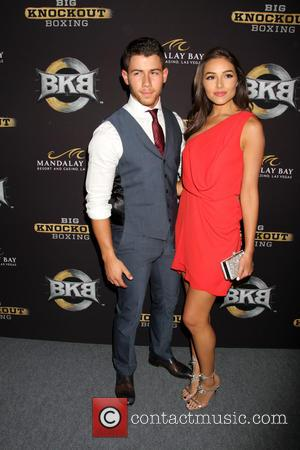 Nick Jonas and Olivia Culpo - Celebrities arrive on the Big Knockout Boxing red carpet at the Mandalay Bay Events...