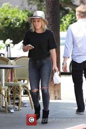 Hilary Duff - Hilary Duff leaving La Conversation Cafe in West Hollywood wearing a wide brimmed hat ripped jeans and...