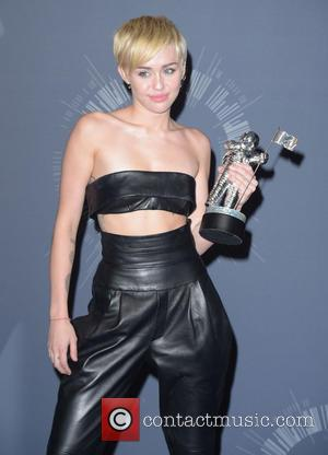 Miley Cyrus - 2014 MTV Video Music Awards at The Forum - Press Room - Los Angeles, California, United States...