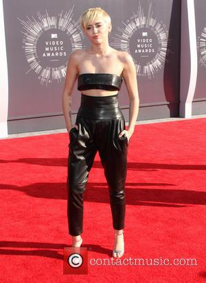 Miley Cyrus - 2014 MTV Video Music Awards at The Forum - Arrivals - Los Angeles, California, United States -...