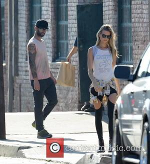 Adam Levine and Behati Prinsloo - Adam Levine and his new model wife Behati Prinsloo hang out on the set...