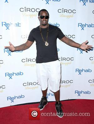 Puff Daddy - American rapper Puff Daddy celebrates Labor Day Weekend at REHAB wearing a black T-shirt and white shorts...