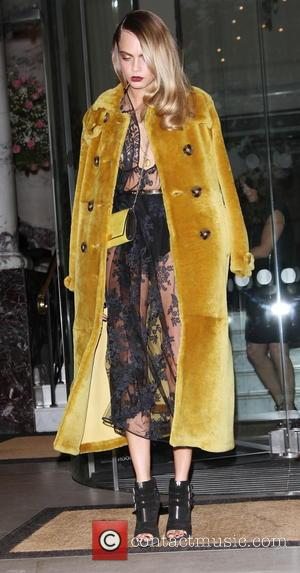 Cara Delevingne - Celebrities leaving The Langham Hotel to attend the GQ Men of the Year Awards - London, United...