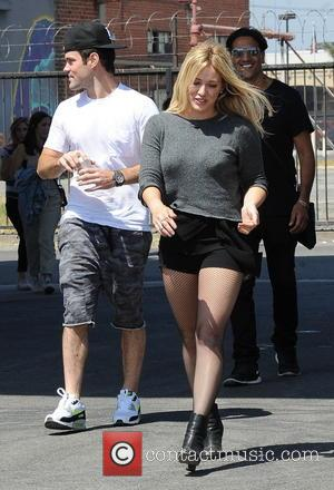 Hilary Duff and Mike Comrie - Hilary Duff, filming her first music video since 2007, is seen on set with...