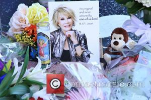 Joan Rivers - Tributes on Joan Rivers' star on the Walk of Fame left by fans after hearing of her...