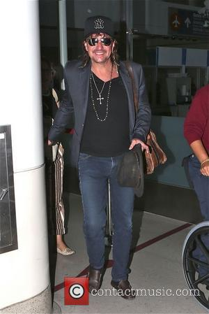 Richie Sambora - Richie Sambora and his girlfriend Orianthi Panagaris arrive at Los Angeles International Airport (LAX) - Los Angeles,...
