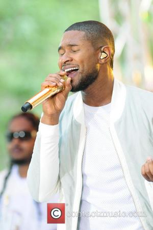 Usher Delays 2014 Release Of New Album