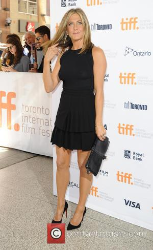 Jennifer Aniston - Stars of new film 'Cake' Jennifer Aniston and Sam Worthington photographed at the 2014 Toronto International Film...