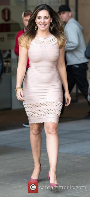 British Glamour model Kelly Brook was photographed outside the BBC Radio 1 studio's wearing a body hugging, knee length, sleeveless...