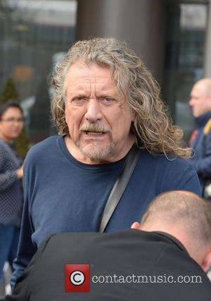 Robert Plant Hands Late-night Tv Host A Joint During Interview