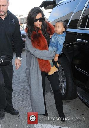 Kim Kardashian and North West - Kim Kardashian and North West arrive at LAX - Los Angeles, California, United States...