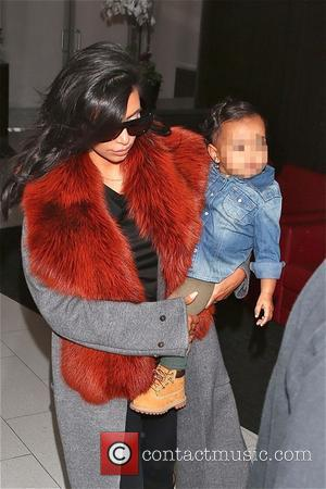 Kim Kardashian and North West - Kim Kardashian and North West  at LAX - Los Angeles, California, United States...