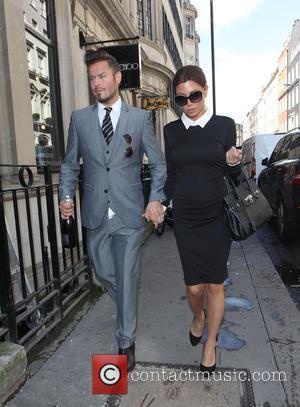Victoria Beckham LOOKALIKE and David Beckham LOOKALIKE - Victoria and David Beckham lookalikes on Dover street - London, United Kingdom...