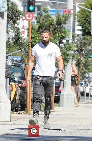 Shia LaBeouf sports a beard and military boots out on La Brea Avenue - Los Angeles, California, United States -...