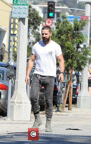 Shia LaBeouf sports a beard and military boots out on La Brea Avenue - Los Angeles, California, United States -...