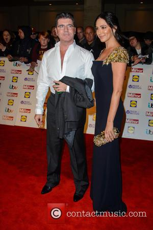Simon Cowell and Lauren Silverman - The Pride Of Britain Awards 2014 - Arrivals - London, United Kingdom - Monday...