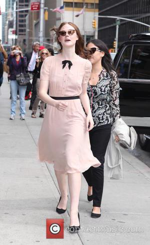 Elle Fanning - Celebrity guests arrive for the 'Late Show with David Letterman' - New York City, New York, United...