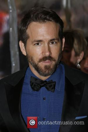 Official 'Deadpool' Photograph Is Released - Ryan Reynolds Reclines In Costume On Bearskin Rug