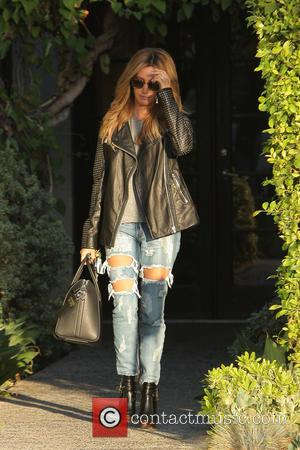 American actress Ashley Tisdale was spotted as she left the Andy LeCompte Salon wearing a black leather jacket and ripped...
