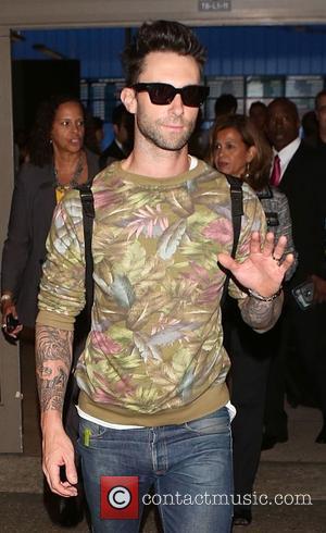Adam Levine and Maroon 5 - Adam Levine arrives at Los Angeles International Airport (LAX) - Los Angeles, California, United...