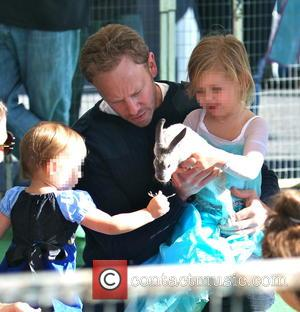 Ian Ziering, Penna Ziering and Mia Ziering - Ian Ziering and his daughters, Penna and Mia, play with a rabbit...