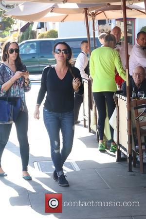 Kyle Richards - Kyle Richards wearing Chanel lambskin aviator sunglasses and matching backpack while lunching at Il Pastaio restaurant in...