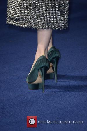 Anne Hathaway and shoes - Photographs of the Hollywood stars as they attended the UK Premiere of Sci-Fi movie 'Interstellar'...