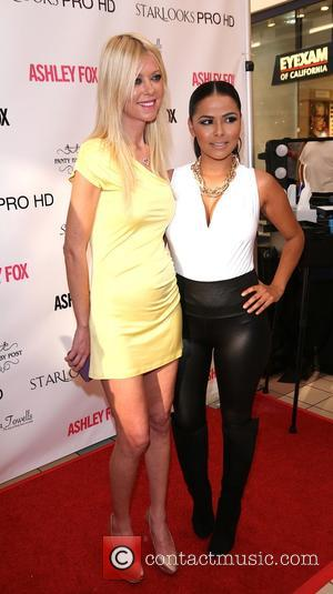 Tara Reid and Mindy Escobar - American actress' Tara Reid and Masiela Lusha were photographed as they launched their signature...