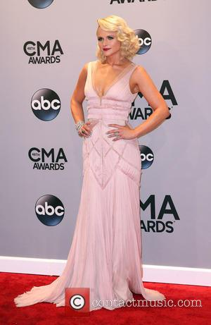 Miranda Lambert - Shots of a variety of stars as they took to the red carpet for the 48th Annual...