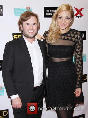 Haley Joel Osment and Abby Elliott