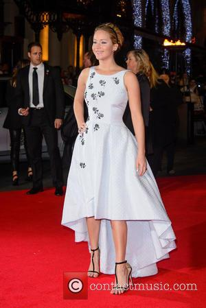 Jennifer Lawrence - Shots from the red carpet ahead of the world premiere of the latest film in the Hunger...