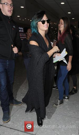 American pop star Demi Lovato was snapped as she arrived at Heathrow Airport wearing an all black outfit and shades...