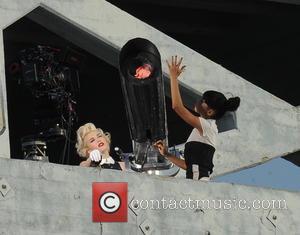 Gwen Stefani - Gwen Stefani mans an giant cannon atop a high rise building in downtown LA while filming a...