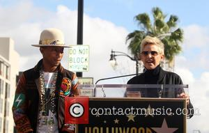 Pharrell Williams and Ellen DeGeneres - Pharrell Williams honored with a star on the Hollywood Walk of Fame at Hollywood...