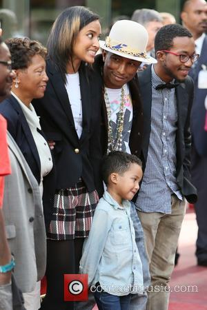 Pharrell Williams, Helen Lasichanh, Rocket Williams and Carolyn Williams - American pop star Pharrell Williams was presented with a Hollywood...