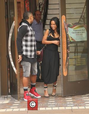 Karrueche Tran - Karrueche Tran goes shopping at The Grove in Hollywood with a male companion - Los Angeles, California,...